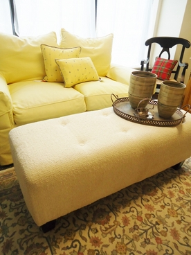 Ivory Upholstered Ottoman